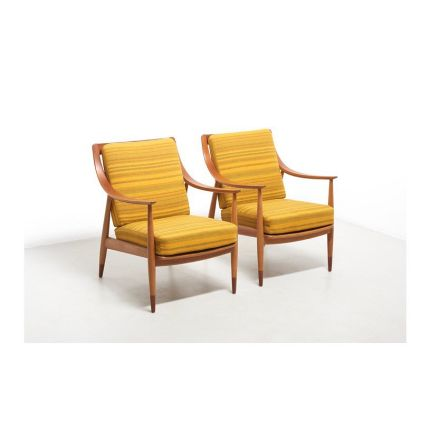 A pair of easy chairs designed in 1953 by Peter Hvidt and Orla Mølgaard-Nielsen. Model FD 144, made by France & Daverkosen. The frames are made of oak